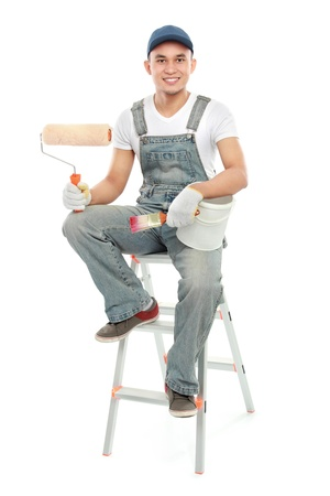 portrait of male Painter worker with paintbrush isolated over white background