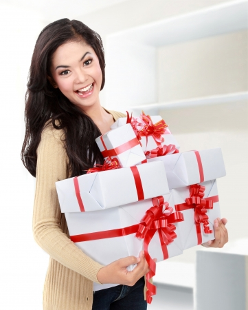 portrait of smiling young girl bring some gift Stock Photo