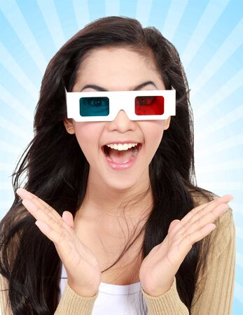 Teenager watching a 3D movie with retro 3D glasses photo