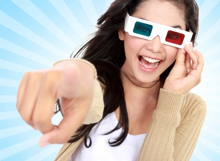 young girl  watching the movie and wear 3D glasses photo