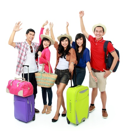 group of young eople bring suitcase going on vacation photo