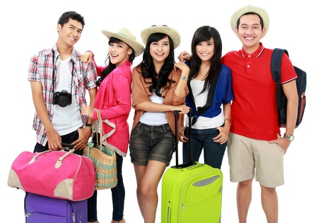 group of young people bringing bag and suitcase going on vacation photo