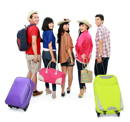 viewed from behind: group of happy young tourist going on vacation bring suitcase viewed from behind