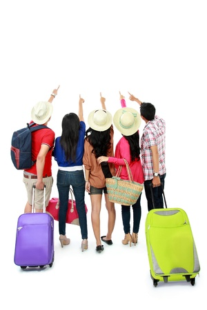GROUP TRAVEL: group of tourist staying together and looking at above
