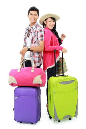 bring: portrait of happy couple tourist bring suitcase and smile