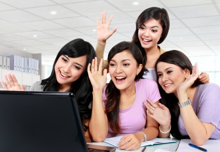 group of girls playing with laptop camera Stock Photo - 18892363