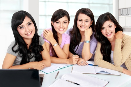 group of girls studying together in campus photo