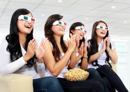 Group of girls clapping watching good 3D movie at home Stock Photo - 18121546