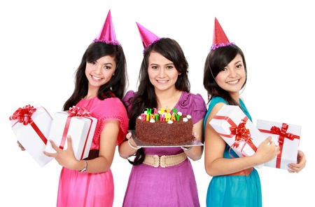 three young beautiful girls celebrate birthday with cake and gift boxes photo