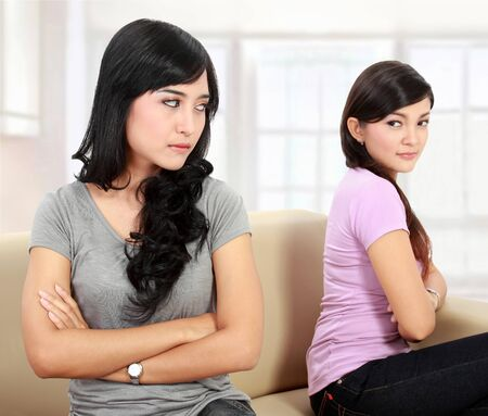hate: portrait of girls hate each other Stock Photo