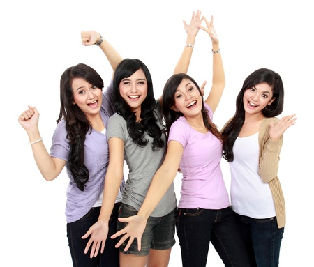 Group of happy teenagers celebrating success Stock Photo