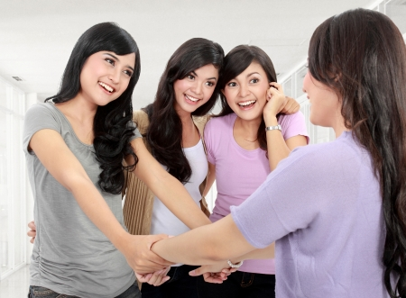 Happy group of woman meet old friend somewhere Stock Photo