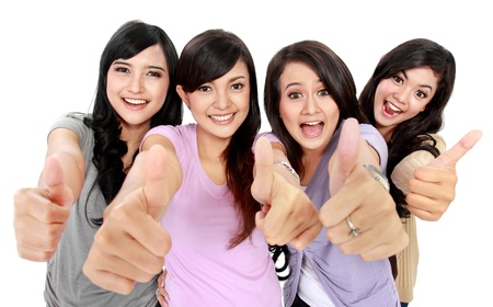thumbs up group: Group of beautiful women showing thumbs up together to camera