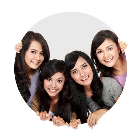 pretty teen girl: portrait of four asian woman in circle Stock Photo