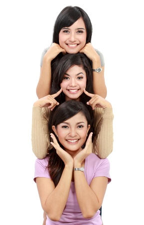 Happy group of girls in good pose smiling isolated on white background Stock Photo - 18121418
