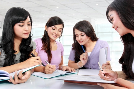 group of students studying in the classroom photo
