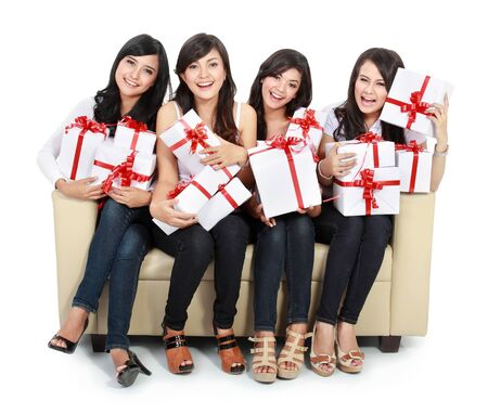 group of Beautiful young woman with many gift boxes sitting on the sofa Stock Photo - 18121410