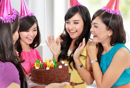 group of young woman celebrating her friend birthday photo