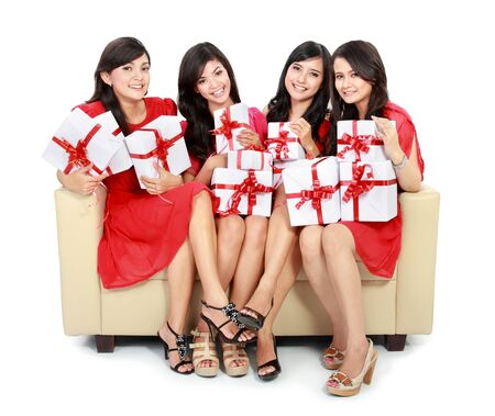 group of Beautiful young woman dress in red with many gift boxes sitting on the sofa Stock Photo - 18121260