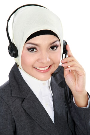 close up portrait of Young beautiful Muslim business woman with headset isolated over white  photo