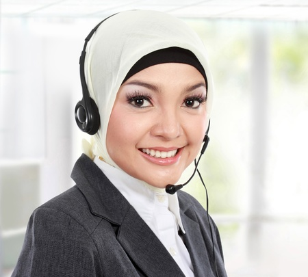phone operator: close up portrait of Young beautiful Muslim woman customer service operator with headset on white background