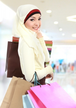 muslim woman shopping in the mall photo