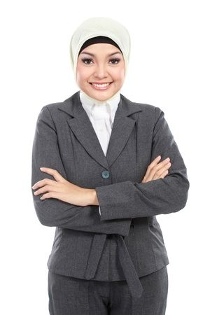 moslem: portrait of smiling Muslim business woman isolated on white background