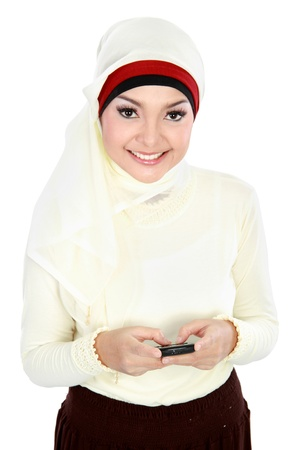 Pretty young Asian Muslim woman text a message isolated on white background photo