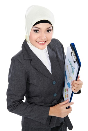 muslims: portrait of smiling Muslim business woman isolated on white background