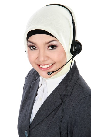 close up portrait of Young beautiful Muslim woman customer service operator with headset isolated on white background Foto de archivo