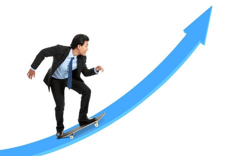 executive on skateboard going up the rising chart isolated over white background photo