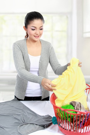 doing laundry: asian woman doing the laundry at home Stock Photo
