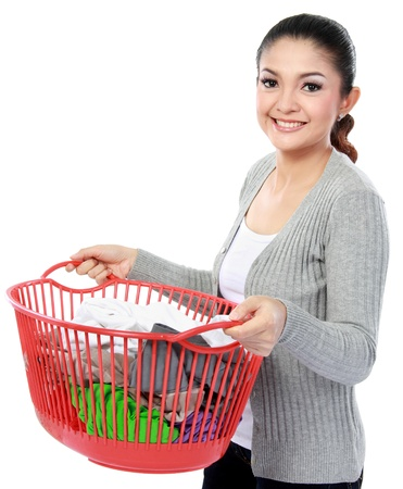 happy asian woman with a basket of loundry isolated over white background photo