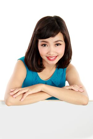 sales executive: Happy smiling young woman showing blank signboard, over white background Stock Photo