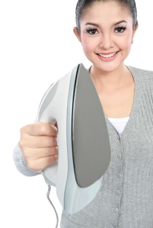 Happy young beautiful woman showing iron to the camera photo