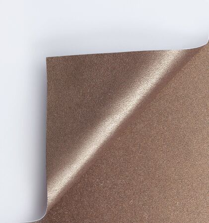 turn over: Curled bronze page corner ready for your design
