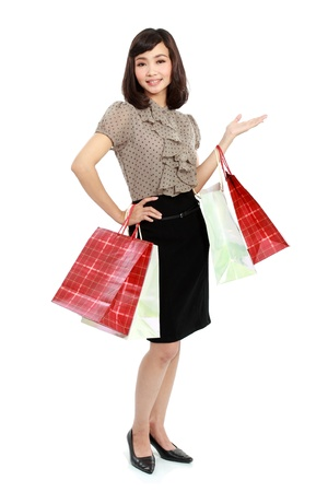 Happy smiling business woman in suit with shopping bag isolated on white background photo