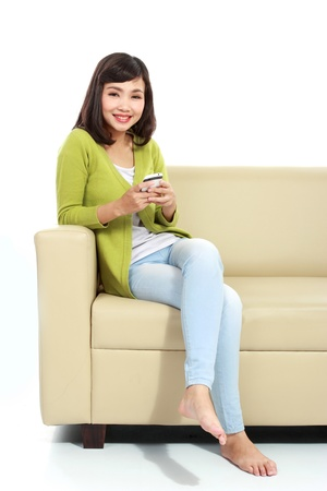 Smiling woman texting on cell phone portrait isolated on white background photo