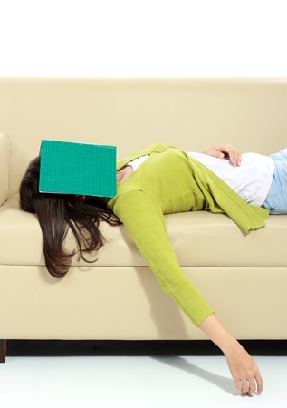 Tired young female sleeping on sofa photo