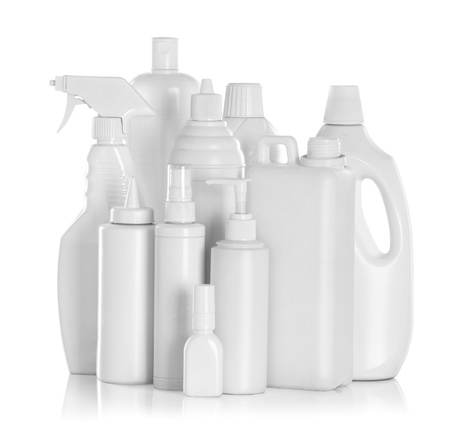 detergent bottles and chemical cleaning supplies isolated on white photo