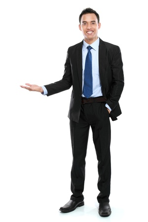 smiling asian business man presenting a blank space ready for your text. isolated over white background photo