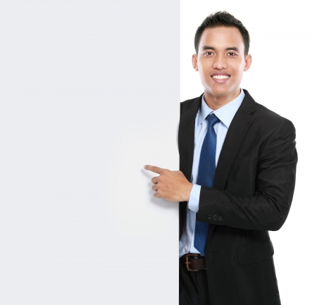 smiling asian business man holding empty board. ready for your design photo