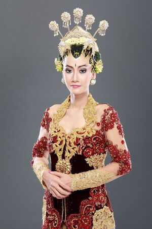 woman traditional wedding dress of java. studio portrait photo