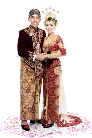 java: traditional java wedding couple husband and wife hold each other isolated over white background Stock Photo