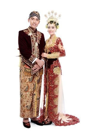 traditional java wedding couple husband and wife hold each other isolated over white background Stock Photo