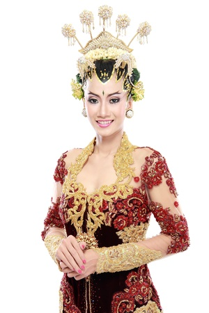 woman traditional wedding dress of java. isolated over white background photo