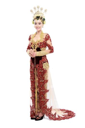 woman traditional wedding dress of java. isolated over white background Stock Photo