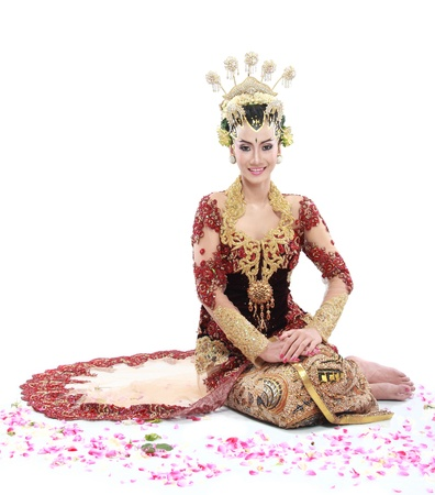 traditional dress: woman traditional wedding dress of java. isolated over white background Stock Photo