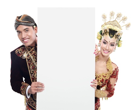 traditional java wedding couple husband and wife holding blank board Stock Photo