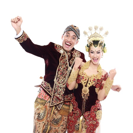 happy traditional java wedding couple husband and wife embrace each other isolated over white background